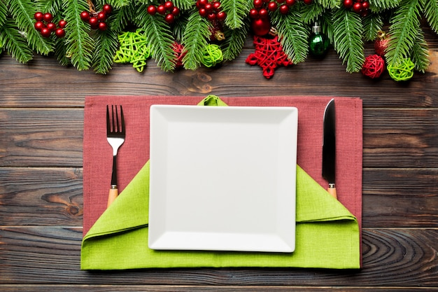 Top view of new year dinner on festive wooden background