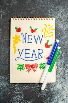 Top view of new year note on a grey surface