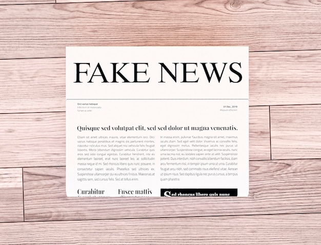 Top view of newspaper with fake news