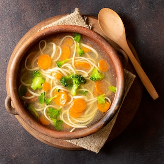 Top view noodle soup for winter meals in bowl