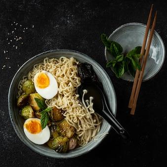 Top view noodles in a bowl arrangement