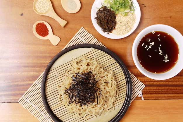 Top view noodles with black nori and sauce