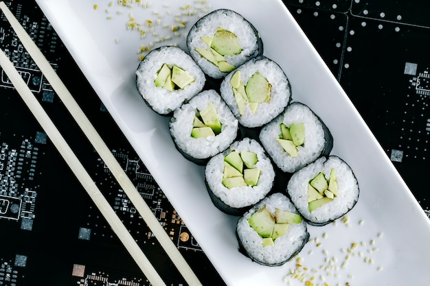 Top view of nori sushi rolls with avocado