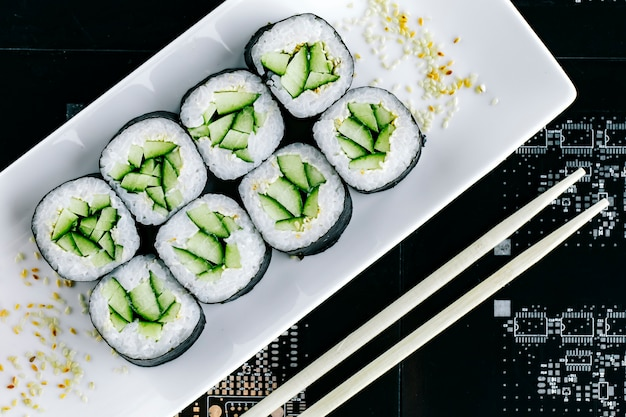 Top view of nori sushi rolls with cucumber