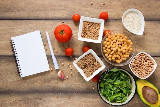 Top view notebook mock-up next to vegan goodies