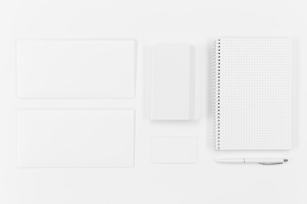 Top view notebook and paper pieces