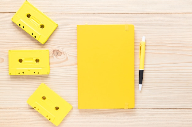 Top view notebook with audio cassettes