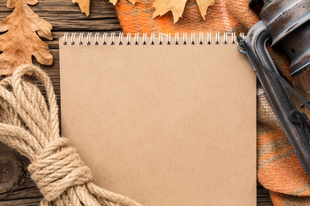 Top view of notebook with autumn leaves