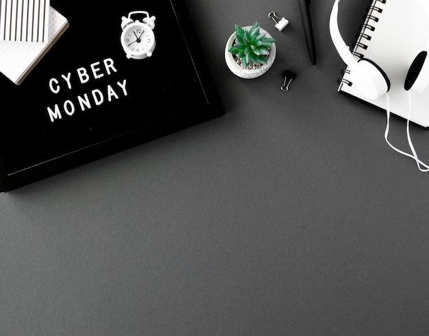 Top view of notebook with clock and headphones for cyber monday