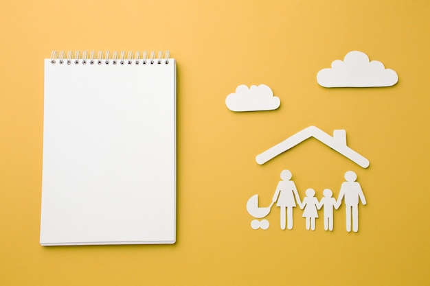 Top view notebook with family figure and clouds