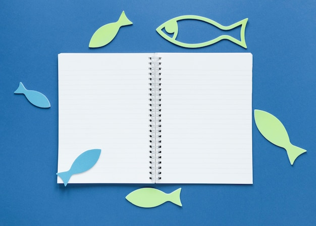 Top view of notebook with fish
