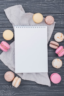 Top view of notebook with macarons