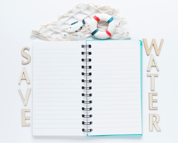 Top view of notebook with message and fishing net