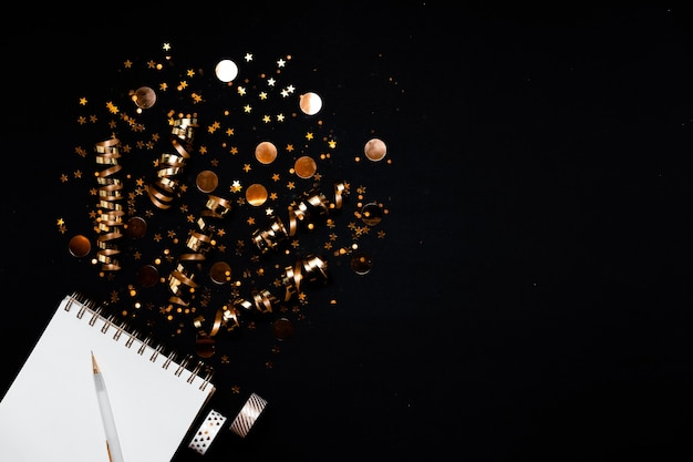 Top view on notebook with new year wishlist