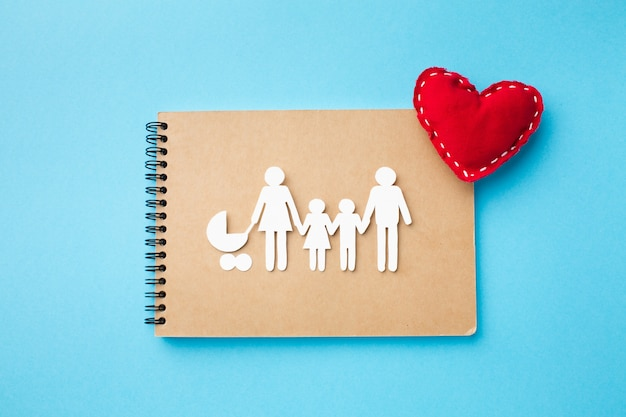 Top view notebook with paper cut family concept