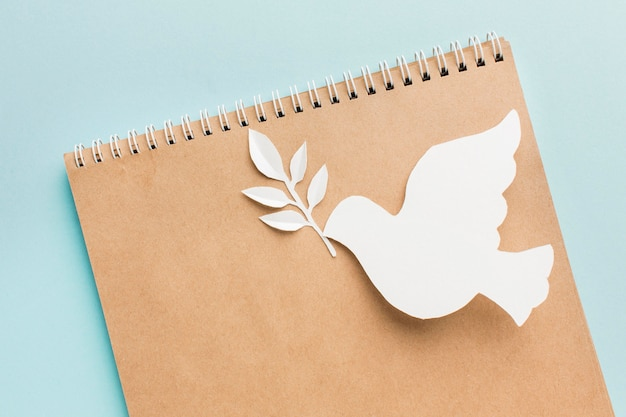 Top view of notebook with paper dove