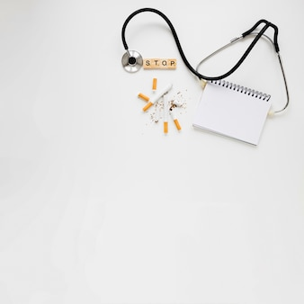 Top view notebook with stethoscope