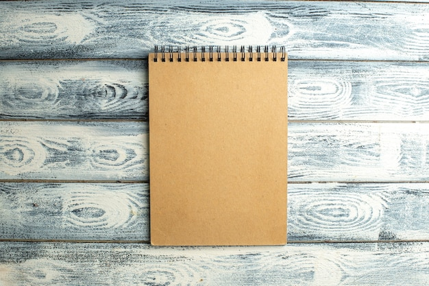 Top view notebook on wooden background