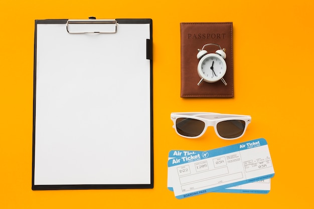 Top view of notepad and other travel essentials