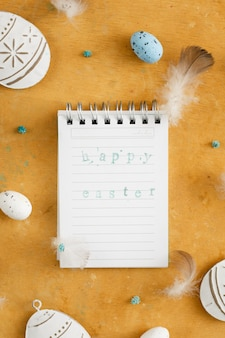 Top view notepad paper with easter greeting