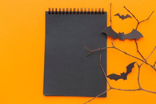 Top view notepad surrounded by bats for halloween