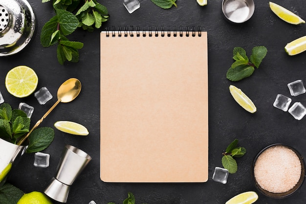 Top view of notepad with cocktail essentials