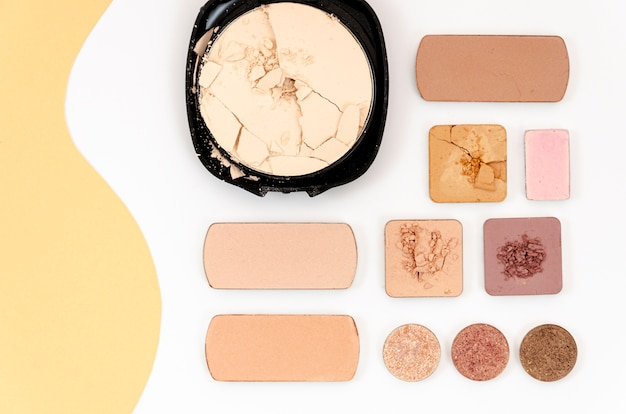 Top view nude cosmetics on white background