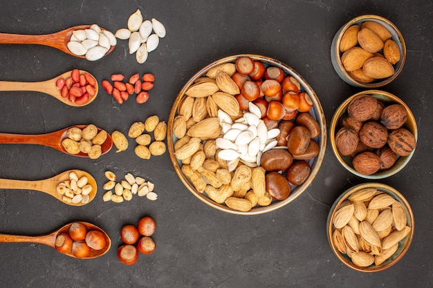 Top view of nut composition with different nuts on dark surface