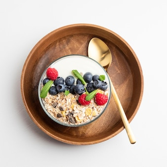 Top view of oatmeal bowl with raspberries and blueberries
