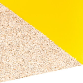 Top view of oatmeal flakes in minimal style