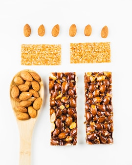 Top view of almond and sesame energy bars on white background