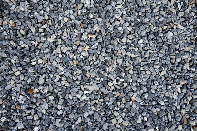 파란색 건설 자갈 질감 배경의 상위 뷰입니다. 작은 화강암 돌 전체 프레임 배경입니다.