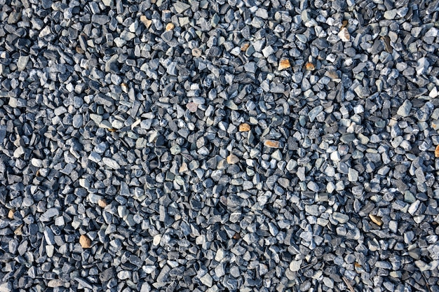 青い建設砂利テクスチャ背景の上面図。小さな花崗岩の石のフルフレームの背景。