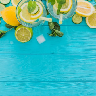 Top view of blue wooden surface with summer drinks