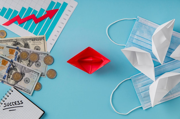 成長チャートと医療用マスクを備えたビジネスアイテムの上面図