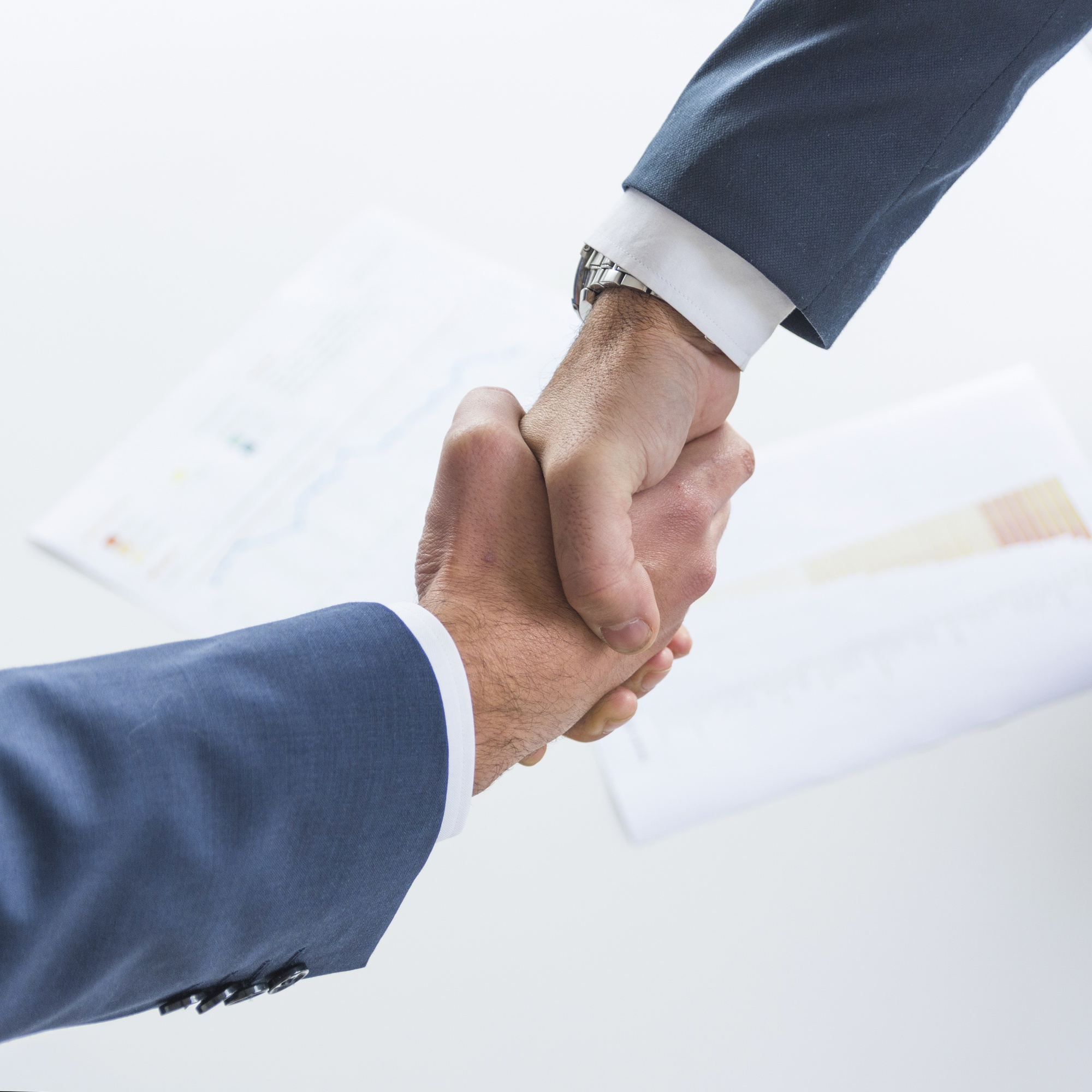 Top view of business people shaking hands together