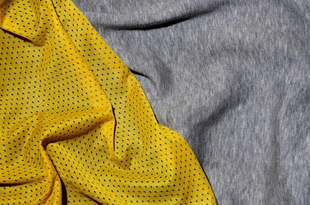 Вид сверху ткани текстильной поверхности. крупный план помятого утеплителя и трикотажного полотна текстуры