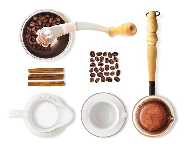 白い背景で隔離のコーヒーの平面図です。コーヒー豆、カップ、ミルク、グラインダーなどのセット。