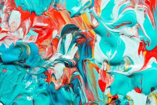 표면에 창조적 인 색된 페인트의 상위 뷰