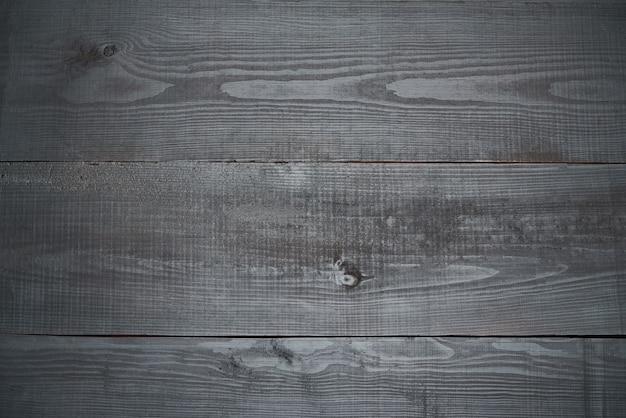 Вид сверху темной деревянной текстуры или фона