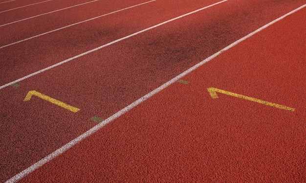 육상을 위한 빈 빨간색 경마장의 최고 전망. 근접 촬영