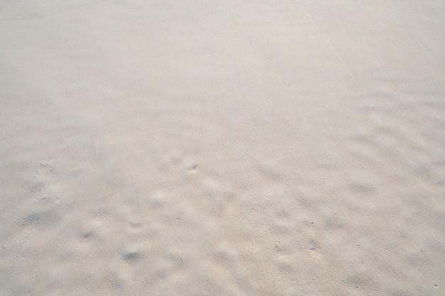 좋은 모래 질감 자연 배경의 상위 뷰 여름 및 여행 배경입니다.