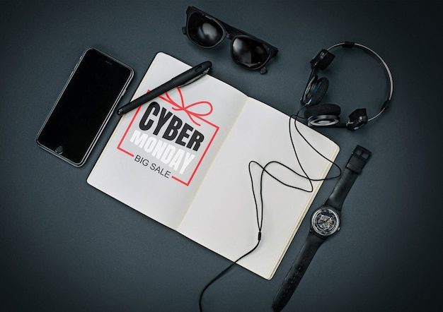 黒の背景にサイバーマンデーのレタリングとガジェットの上面図。広告のコピースペース。ブラックフライデー、販売、金融、広告、お金、金融、購入の概念。ヘッドフォン、時計、スマートフォン。