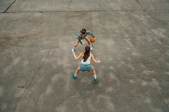 Top view of girls playing basketball