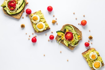 Top view of healthy sandwich with boiled egg and sliced avocado