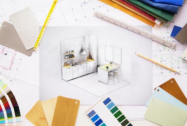 Вид сверху на проект рабочего стола дизайнера интерьера в окружении инструментов и материалов