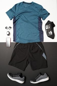 黒と白の背景に男性のランニング機器の平面図です。健康的なライフスタイルのコンセプト