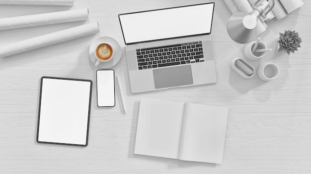 ノートパソコンタブレット携帯電話と文房具のオフィスのテーブルの上から見る