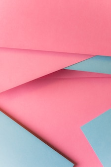 Top view of pink and gray card paper abstract background