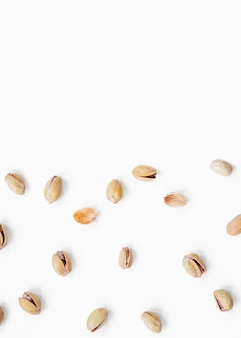 Top view of pistachio spread on white background